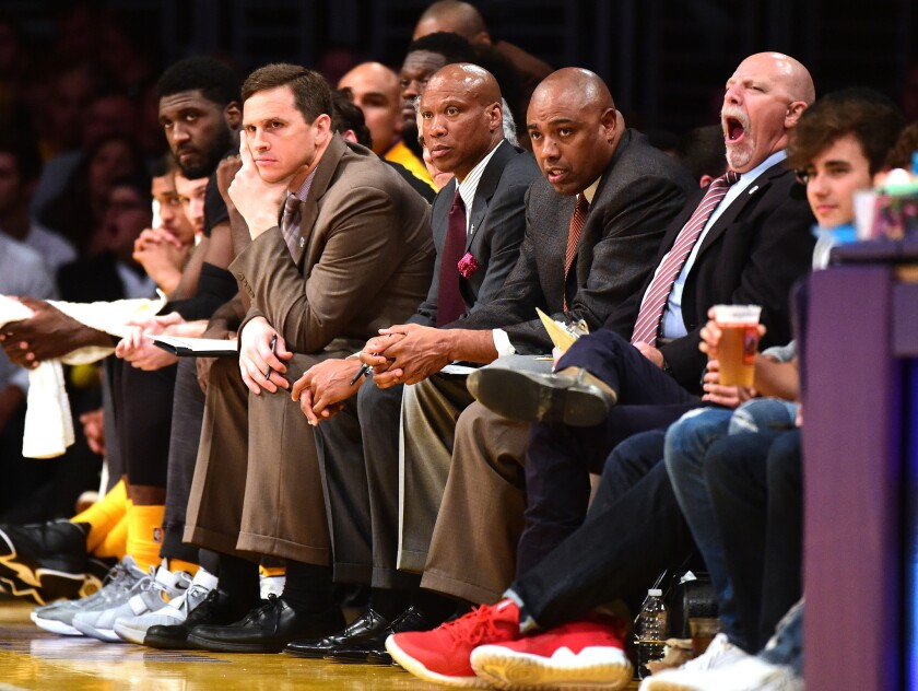 Lakers Coach Byron Scott and members of his coaching staff look on from the bench during a game against the Grizzlies on Feb. 26.