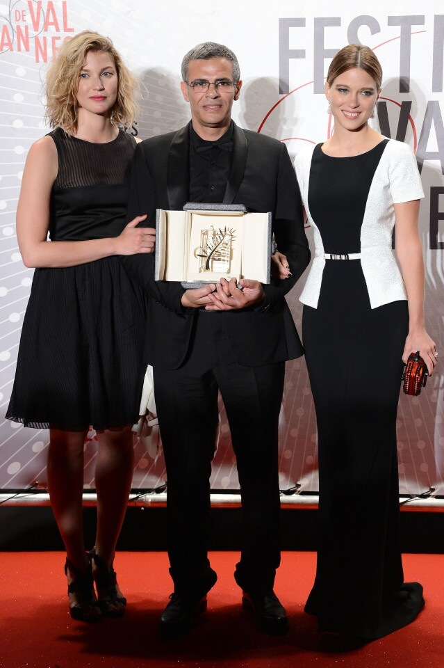 """Actress Mona Walravens, left, director Abdellatif Kechiche and actress Lea Seydoux, winner of the Palme d'Or for """"La Vie D'adele"""" (""""Blue Is the Warmest Color""""), attend the Palme D'Or Winners dinner."""