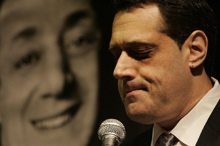 With Harvey Milk's image in the background, Stuart Milk spoke to a San  Diego audience yesterday about his uncle.