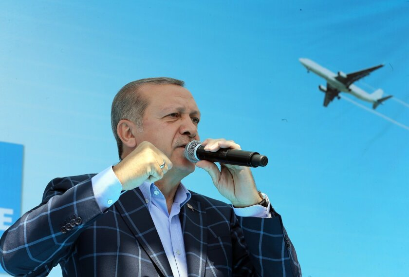 Turkey's President Recep Tayyip Erdogan addresses a rally in the mainly Kurdish city of Diyarbakir, Turkey, Saturday, May 28, 2016.  Erdogan pressed ahead with his criticism of the United States over the U.S. troops' wearing the patches of Syrian Kurdish forces, despite U.S. assurances. (Basin Bulb