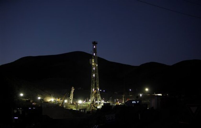 A view of the San Jose mine where drilling machines are working to rescue 33 trapped miners in Copiapo, Chile, Wednesday, Oct. 6, 2010. The miners have been trapped deep underground in the copper and gold mine since it collapsed on Aug. 5. (AP Photo/Natacha Pisarenko)