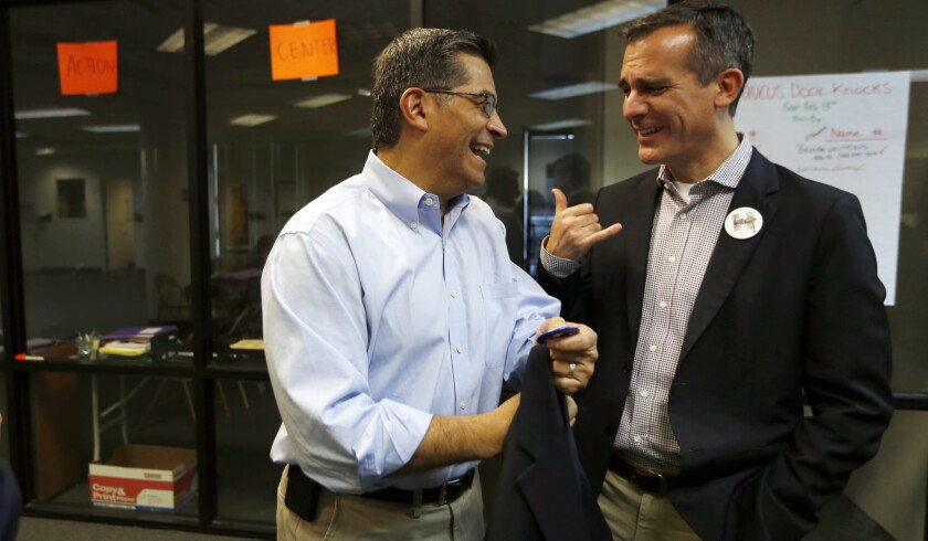 Two Hillary Clinton surrogates, U.S. Rep. Xavier Becerra, left, and Mayor Eric Garcetti, both of Los Angeles, meet before a Nevada rally for Clinton in February.