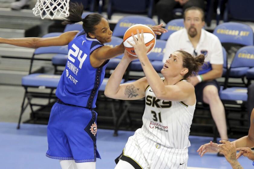 Connecticut Sun's DeWanna Bonner (24) tries to stop Chicago Sky center Stefanie Dolson (31) during a WNBA basketball game Saturday, June 19, 2021, in Chicago. (AP Photo/Eileen T. Meslar)