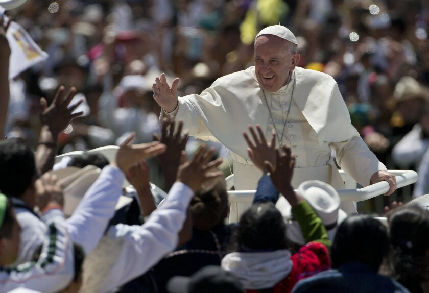 Pope Francis waves to the crowd as he leaves after celebrating Mass in San Cristobal de las Casas, Mexico, Monday, Feb. 15, 2016. Francis is celebrating Mexico's Indians on Monday with a visit to Chiapas state, a center of indigenous culture, where he will preside over a Mass in three native langua