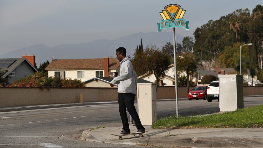A skateboarder crosses the intersection at Lark Ellen Avenue and Amar Road.