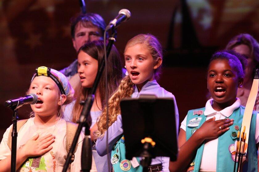 Girl Scouts Sophia Benito, Kalea Scott, Joelle Vitiello and Shalene Bryant lead the Pledge of Allegiance.