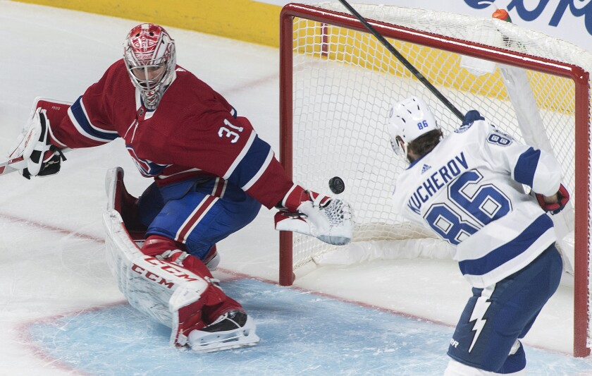 Montreal Canadiens goaltender Carey Price is scored on by Tampa Bay Lightning's Nikita Kucherov during the first period of an NHL hockey game Thursday, Jan. 2, 2020, in Montreal. (Graham Hughes/The Canadian Press via AP)