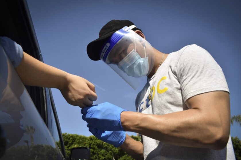A trained volunteer collects a blood sample