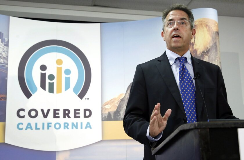 FILE - In this Nov. 13, 2013 file photo, Peter Lee, executive director of Covered California, the state's health insurance exchange, talks at a news conference in Sacramento, Calif. Long before it opened its doors to the public last fall, California's health insurance exchange awarded a small contr