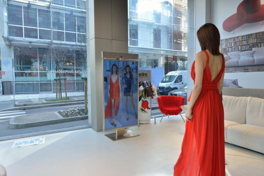 Memomi's digital mirrors allow shoppers to easily compare outfits. The technology is being used by retailers like Neiman Marcus and Sephora.
