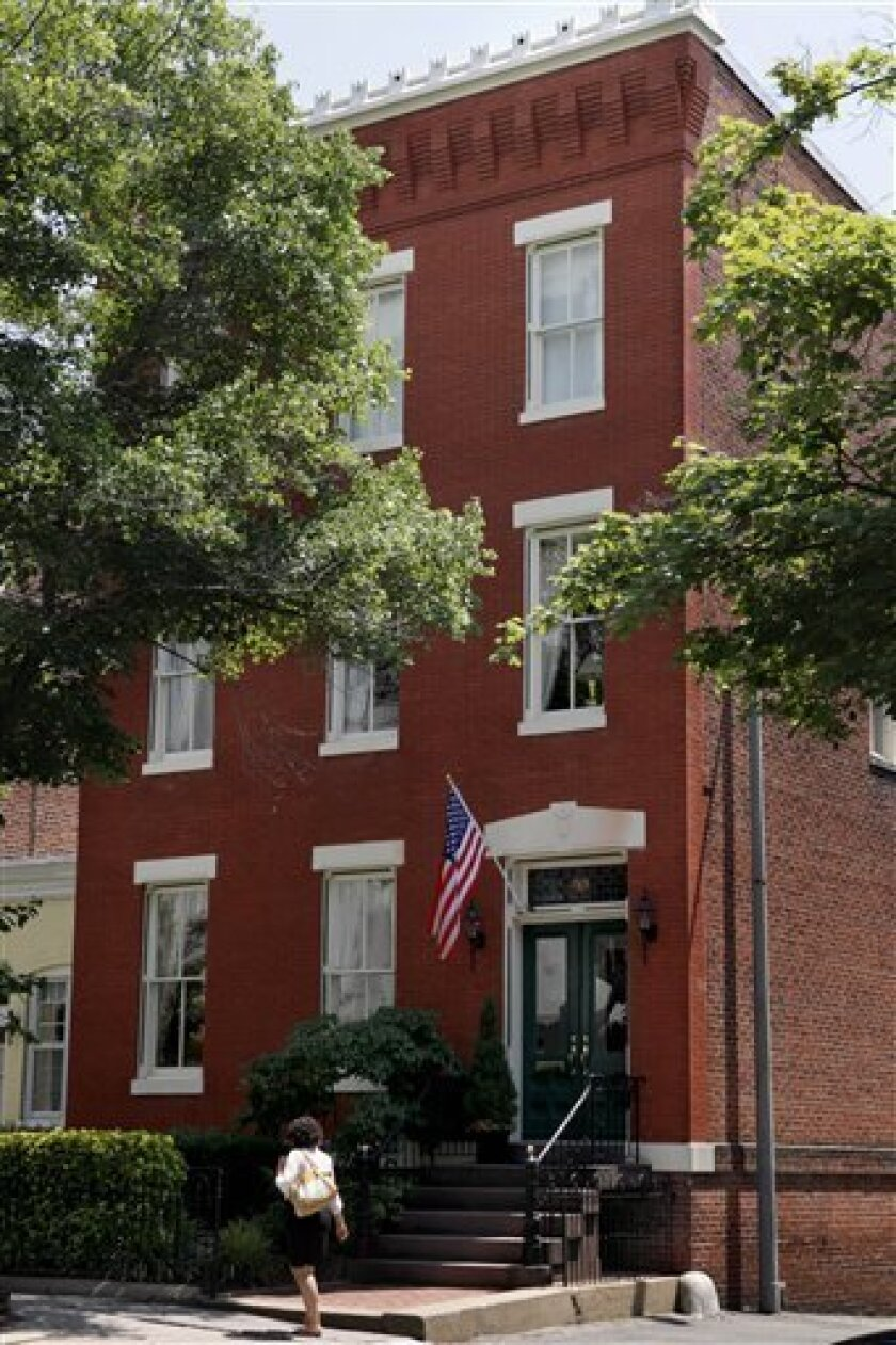 133 C Street S.E., a red-brick structure registered as a church and affiliated with a secretive Christian group known by many names, one of them the Fellowship Foundation, is seen Wednesday, July 1, 2009, in Washington. (AP Photo/Jacquelyn Martin)