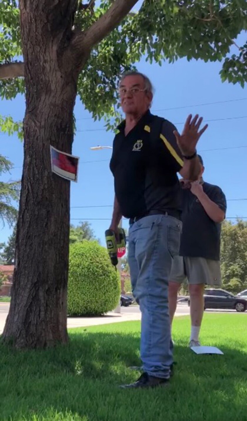 """A screengrab from an iPhone video shows a man telling Marshall-Brown to leave after posting a """"No Trespassing"""" sign."""
