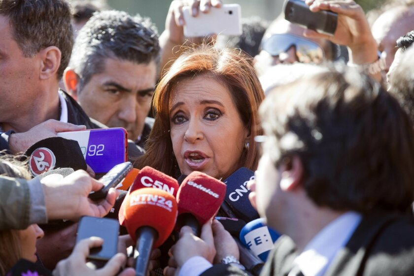 Argentina's former President Cristina Fernandez speaks to the media outside federal court in Buenos Aires, Argentina, Wednesday, July 6, 2016. Fernandez appeared in court to be notified that she is accused of an alleged scheme to manipulate Argentina's currency. (AP Photo/Victor R. Caivano)
