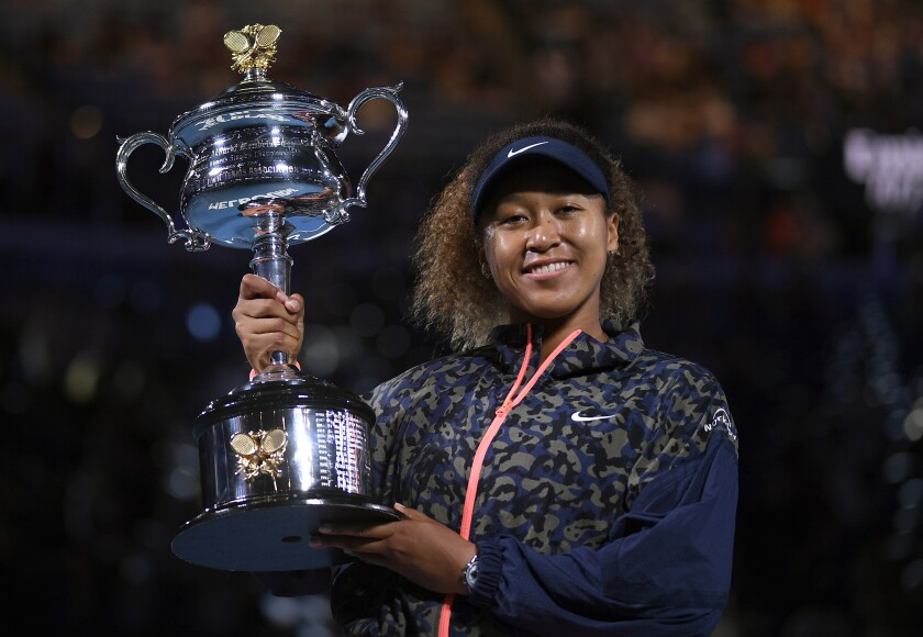 Naomi Osaka holds the Daphne Akhurst Memorial Cup and smiles