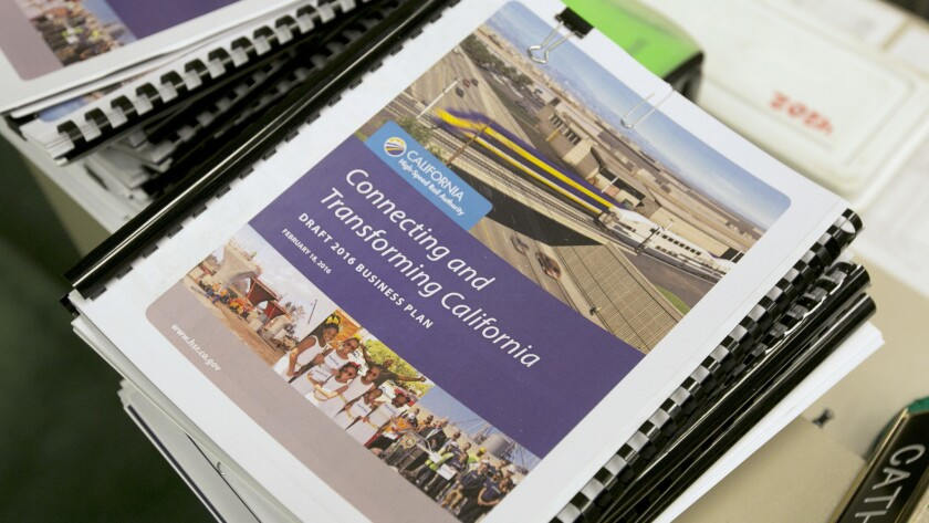 Copies of the proposed business plan for the California high-speed rail authority are seen at a hearing in Sacramento on March 28.