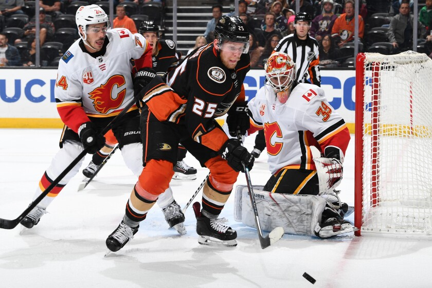 Ducks can't hold back Flames' rally in first home loss of season