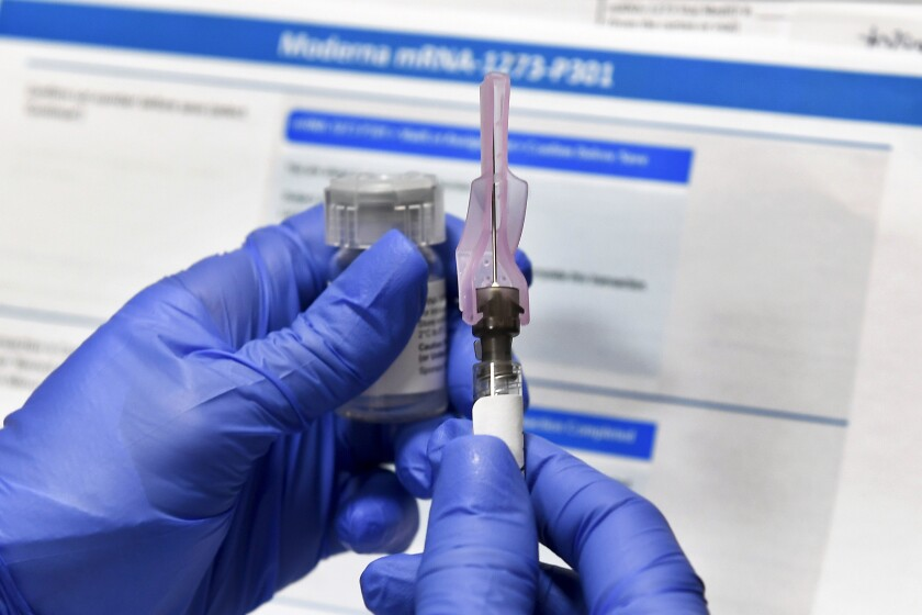 A nurse prepares a syringe during a study of a COVID-19 vaccine developed by the National Institutes of Health and Moderna