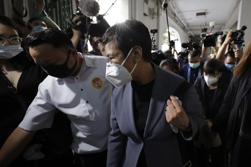 Rappler Chief Executive and Executive Editor Maria Ressa arrives on Monday at Manila Regional Trial Court in the Philippines.