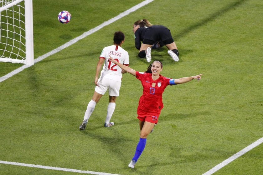 United States' Alex Morgan, right, celebrates her side's second goal during the Women's World Cup se