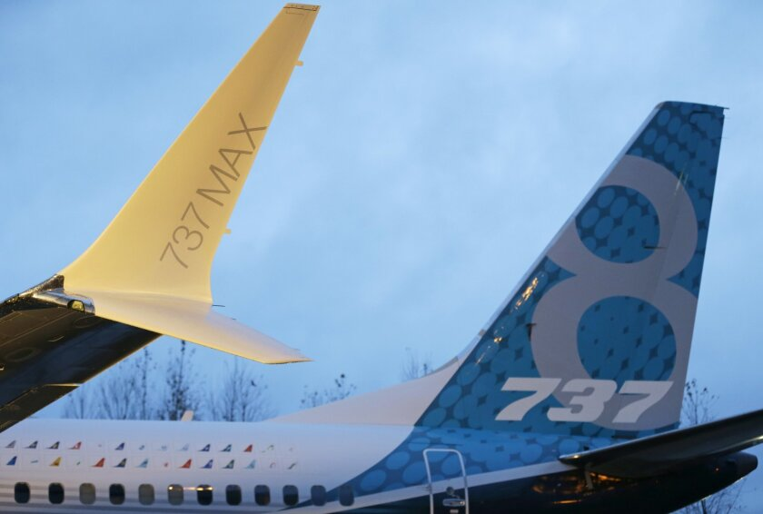 In this Tuesday, Dec. 8, 2015, photo, a winglet and the vertical stabilizer of the first Boeing 737 MAX airplane to roll off Boeing's assembly line in Renton, Wash., are shown before an employee-only rollout event. Boeing reports financial results Wednesday, Jan. 27, 2016. (AP Photo/Ted S. Warren)
