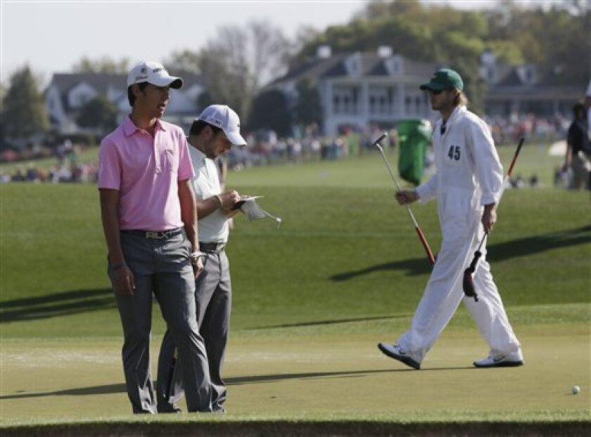 Matteo Manassero, left, of Italy, and Francesco Molinari, of Italy, wait to putt on the second green during a practice round for the Masters golf tournament Tuesday, April 9, 2013, in Augusta, Ga. (AP Photo/Darron Cummings)