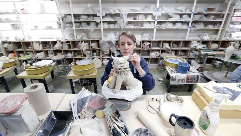 Alison Davies, of Sunland, working on a Shisa, which is a cross between a dog and lion from Okinawan