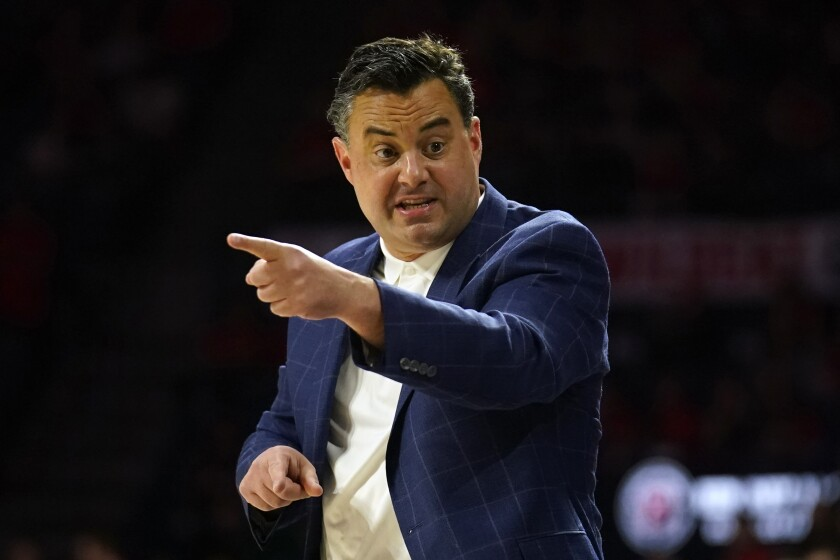 FILE - In this March 7, 2020, file photo, Arizona head coach Sean Miller gestures during the first half of an NCAA college basketball game against Washington, in Tucson, Ariz. Miller has reeled in some of nation's best recruiting classes during his 11-year stint at Arizona. His latest group has a distinctly international slant to it.(AP Photo/Rick Scuteri, File)