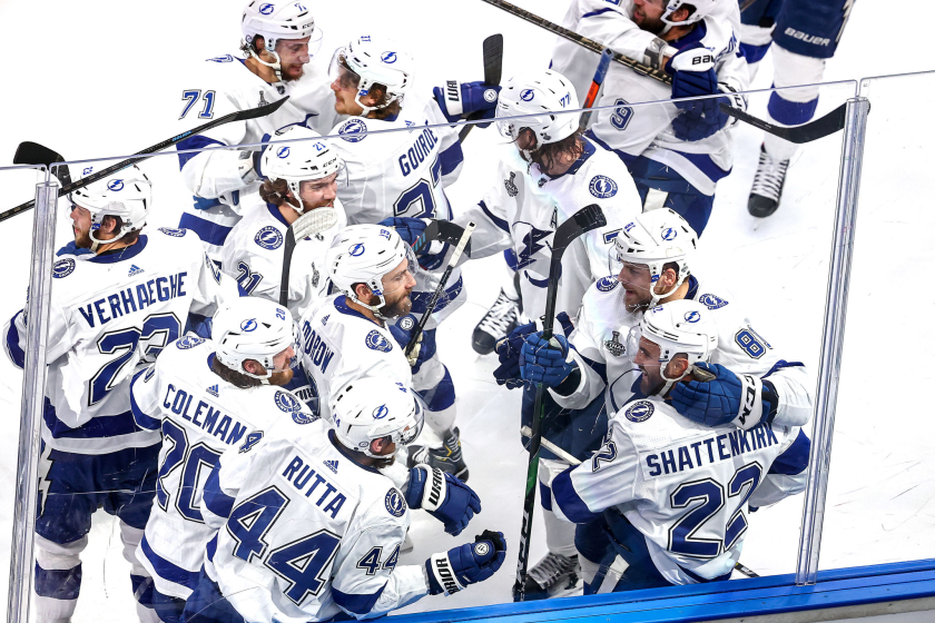 The Lightning's Kevin Shattenkirk (22) is mobbed by teammates after scoring the game-winning goal in overtime Sept. 25, 2020.