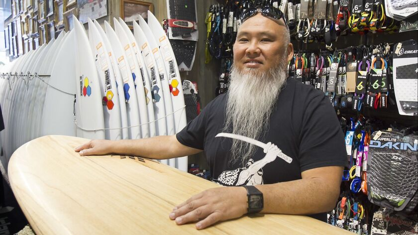 Sumo Sato, the surfing pastor, hangs out at one of his favorite places, Huntington Surf and Sport.