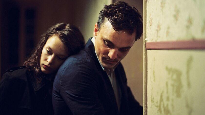"Paula Beer and Franz Rogowski in ""Transit."""