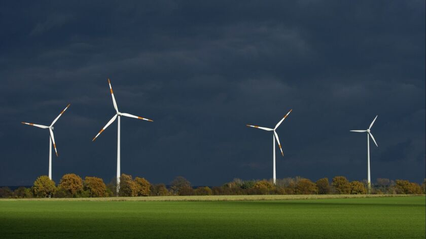 Wind turbines in Furstenwalde, in eastern Germany. Wind power accounts for 160,000 jobs in Germany but the country's integration of renewable energy sources has been less than smooth.
