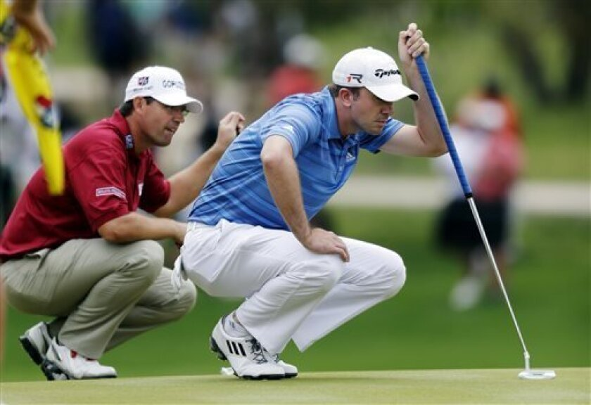 Martin Laird, right, and Padraig Harrington, left, line up their putts on eighth hole during the final round of the Texas Open golf tournament, Sunday, April 7, 2013, in San Antonio. Laird won the tournament; Harrington finished tied for 10th. (AP Photo/Eric Gay)