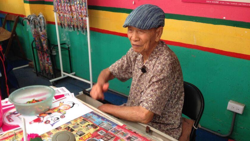 Artist Huang Yung-fu at his desk in the Rainbow Village in Taichung, Taiwan.