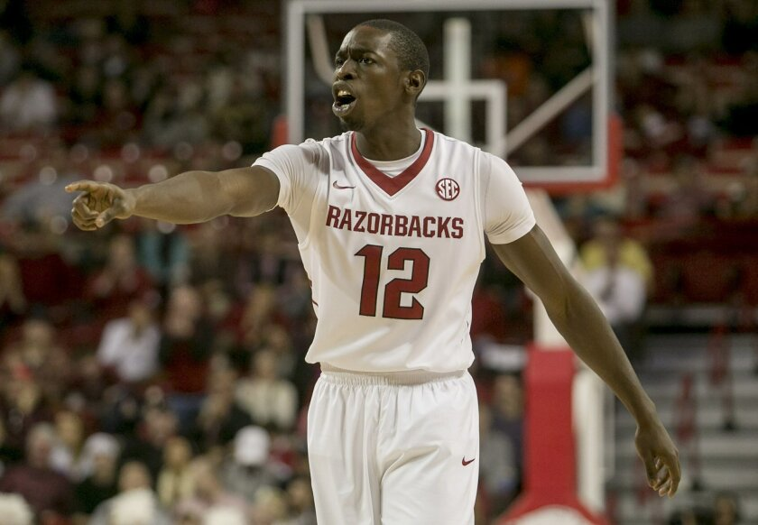 Arkansas guard Fred Gulley III, (12) yells at a teammate during the second half of a NCAA college basketball game against Clemson at Bud Walton Arena in Fayetteville, Ark. Arkansas defeated Clemson 74-68. (AP Photo/Gareth Patterson)