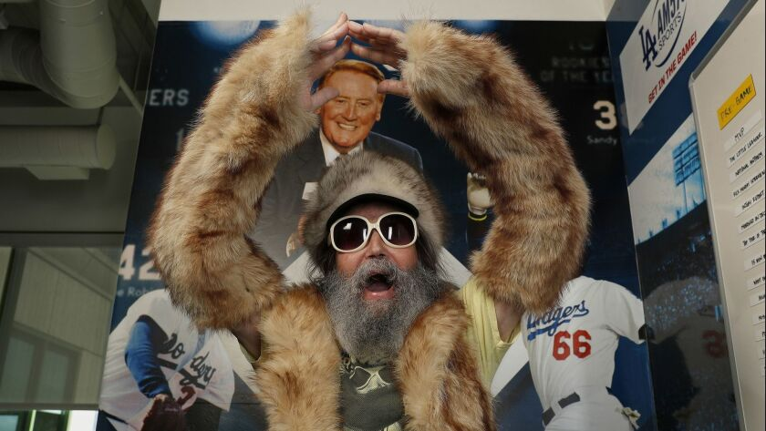 """Radio sports announcer Vic """"the Brick"""" Jacobs is all decked out in his fox fur outfit, while at iHeartMedia in Burbank, where he gives sports updates."""