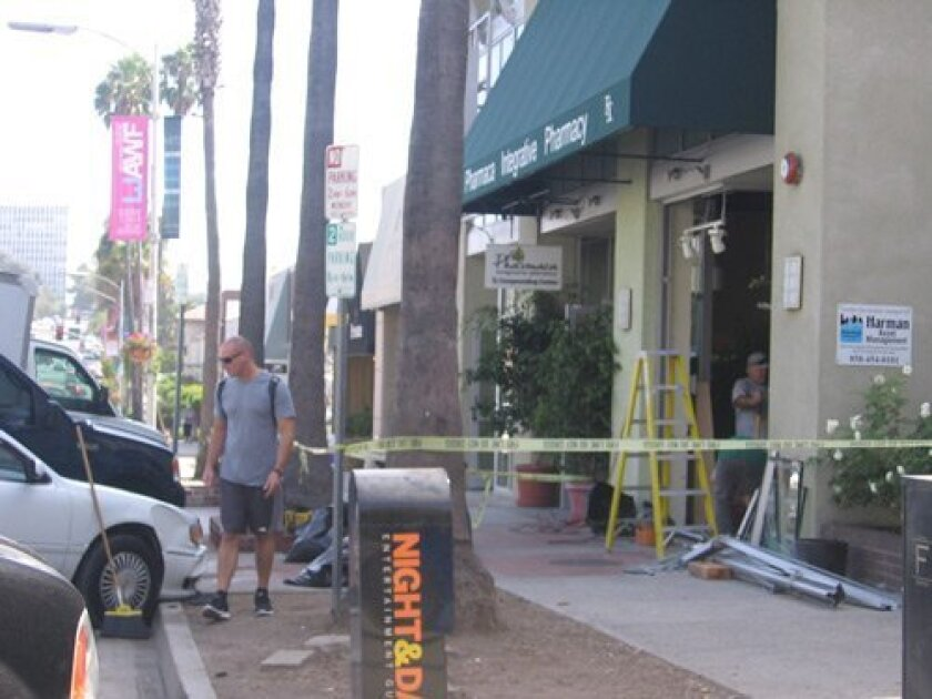 The damaged storefront window of Pharmaca pharmacy in La Jolla after a car crashed into it. Ashley Mackin