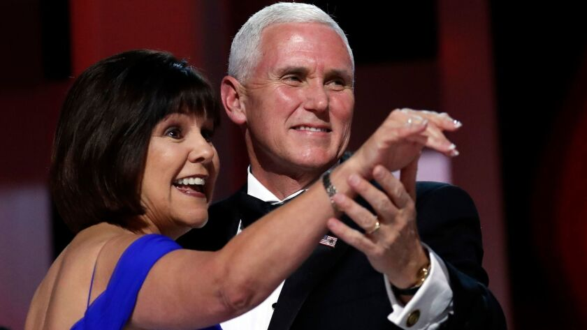 FILE - In this Jan. 20, 2017, file photo, Vice President Mike Pence dances with his wife Karen at th