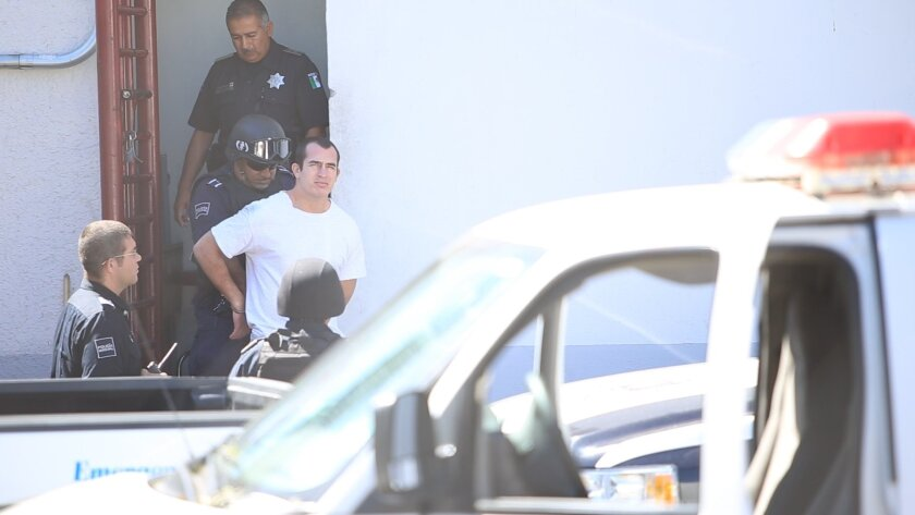 Andrew Tahmooressi, a U.S. Marine veteran undergoing trial on weapons charges, leaves a Tijuana courthouse on Monday.