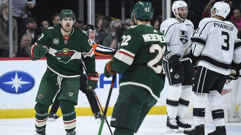 Minnesota Wild's Marcus Foligno (17) celebrates with teammate Nino Niederreiter (22) after a goal by Niederreiter in the second period against the Kings on Tuesday.