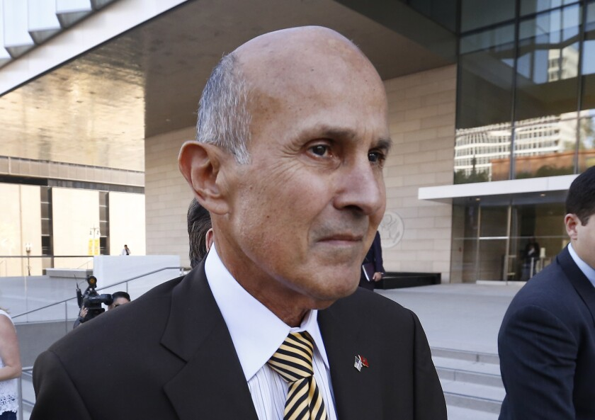 LOS ANGELES - Former Los Angeles County Sheriff Lee Baca departs from the Los Angeles Federal Courthouse in 2017 after he was convicted of three federal charges of orchestrating a scheme to thwart an FBI investigation into inmate mistreatment in the jails he ran
