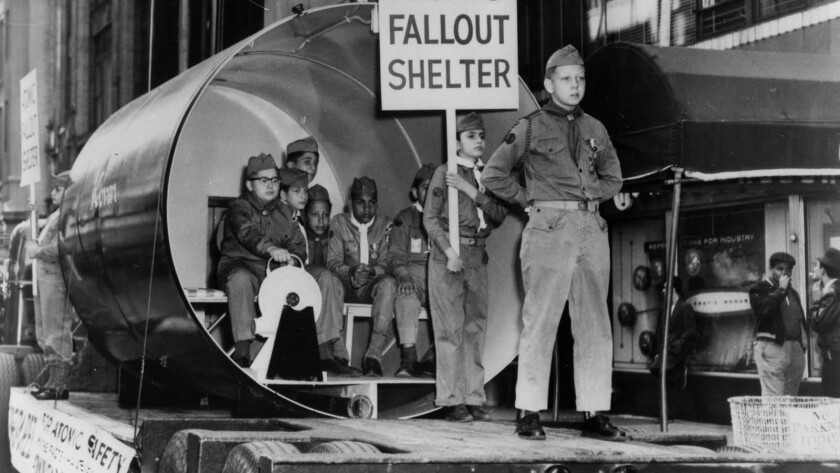 """Civil defense photograph of Boy Scouts in a parade from the documentary """"The Atomic Cafe."""""""