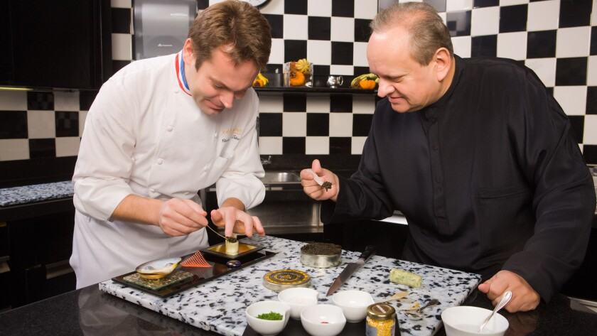 "Executive chef Claude Le-Tohic, left, and Chef Joël Robuchon work in the kitchen of Robuchon's namesake Las Vegas restaurant. A new menu has been introduced that Robuchon calls ""game-changing."""