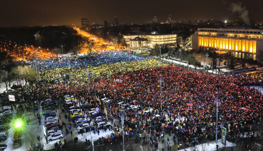 Protesters light the flashes of their mobile phones in the colors of Romania's flag during an anti-government demonstration in Bucharest on Sunday.