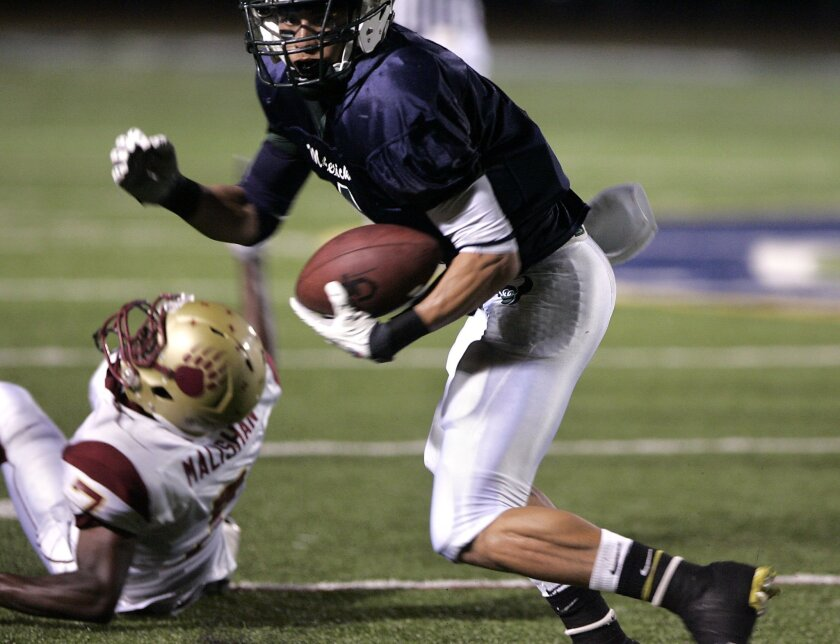 Kenny Stills Jr. had eight catches for 126 yards and threw a 29-yard touchdown pass out of the wildcat formation in last night's 56-7 win over Mission Hills. (John Gastaldo / Union-Tribune)