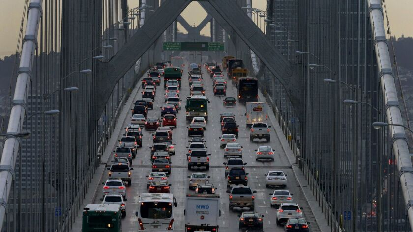 Vehicles travel west on Interstate 80 across the San Francisco-Oakland Bay Bridge in 2015.