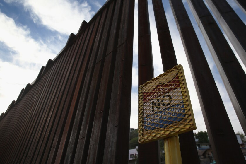 """A federal appeals court Monday denied a Mexican couple's asylum claim, saying there was no evidence that their """"American"""" appearance would subject them to torture after deportation to Mexico. Above, a section of the fence along the U.S.-Mexico border."""