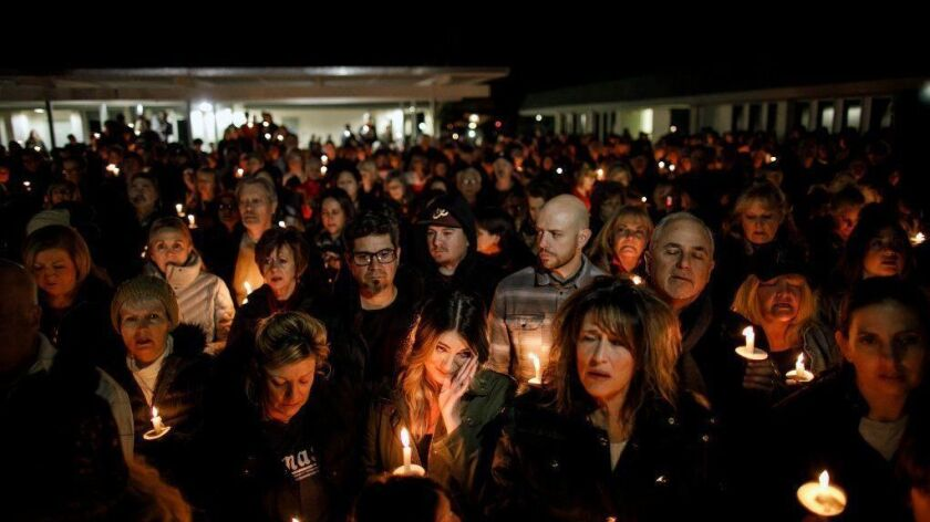 Community members attend a vigil Thursday evening at the Glenknoll Elementary School in Yorba Linda for the four people killed Sunday when pieces of a plane plunged into their home, about an hour before the Super Bowl.