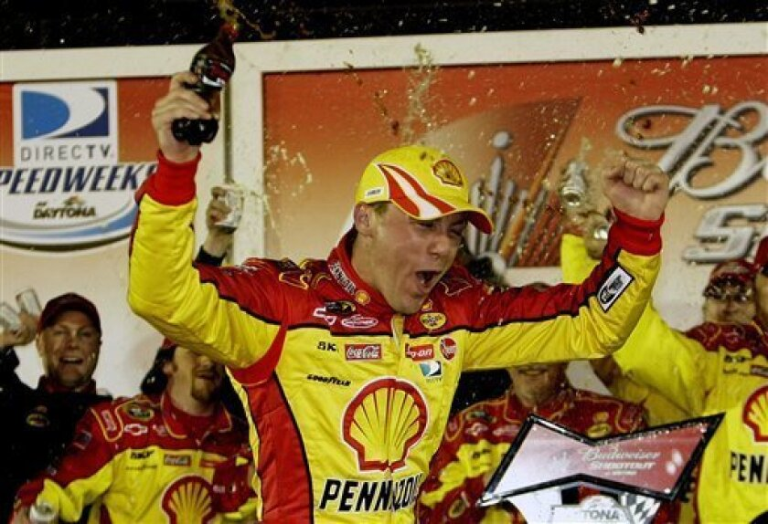 NASCAR driver Kevin Harvick celebrates in Victory Lane after winning the NASCAR Budweiser Shootout auto race at Daytona International Speedway in Daytona Beach, Fla., Saturday, Feb. 7, 2009.(AP Photo/John Raoux)