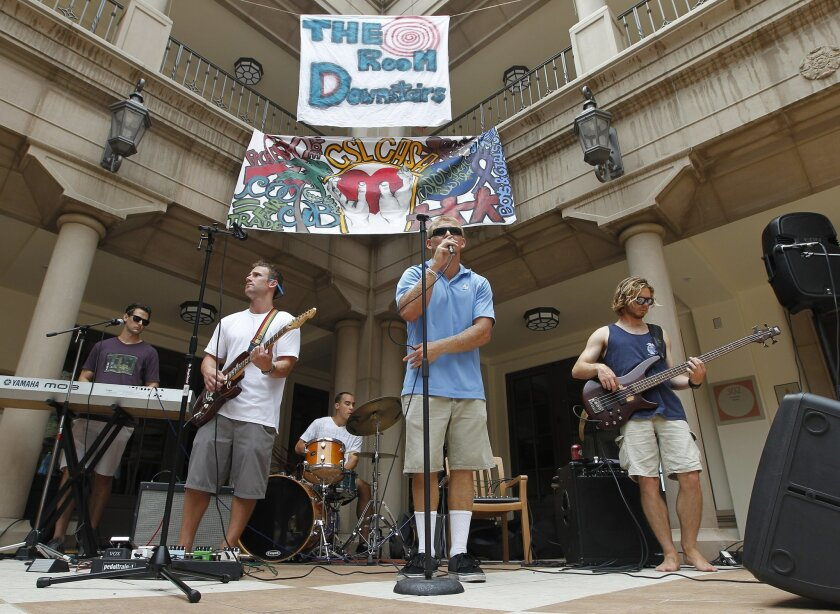 "Robbie Beathard, a safety for USD's football team, preforms as a lead singer for the band ""The Room Downstairs"" at a welcome to new students day at USD."