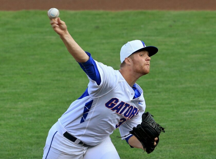FILE - In this June 13, 2015 file photo, Florida starting pitcher Logan Shore throws during an NCAA College World Series baseball game against Miami in Omaha, Neb. Shore and fellow pitchers A.J. Puk and Alex Faedo are an imposing weekend rotation that combined for a 26-11 record last season. (AP Ph
